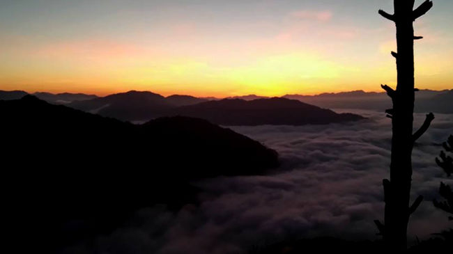 How 'bout a view of the sea of clouds at the top of Mt. Kiltepan? Beauty In Nature Calm Cloud Cloud - Sky Dramatic Sky Idyllic Landscape Majestic Moody Sky Mountain Mountain Range Nature No People Non Urban Scene Non-urban Scene Orange Color Outdoors Outline Remote Scenics Silhouette Sky Sunset Tranquil Scene Tranquility