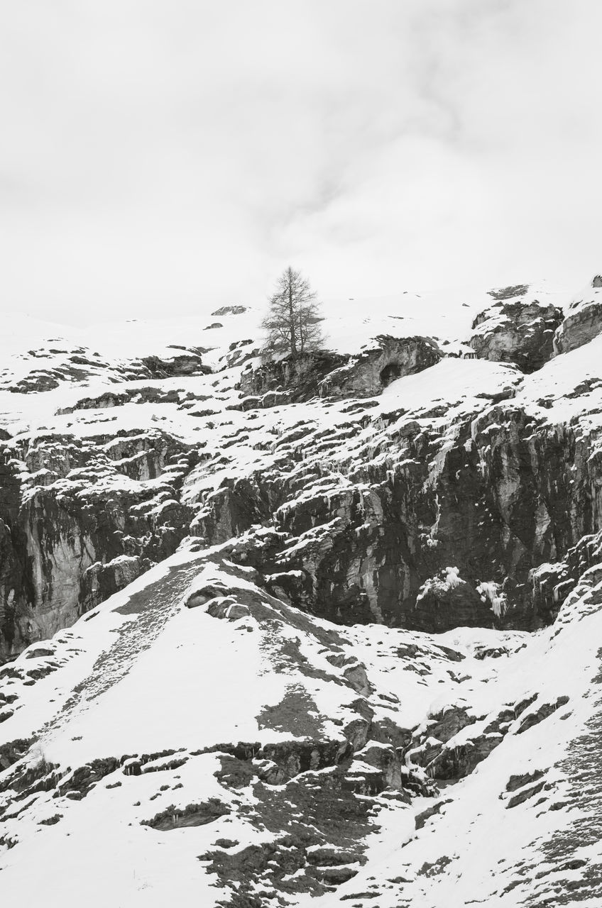 snow, winter, cold temperature, mountain, nature, beauty in nature, weather, scenics, tranquility, tranquil scene, outdoors, snowcapped mountain, day, no people, mountain range, landscape, sky, tree