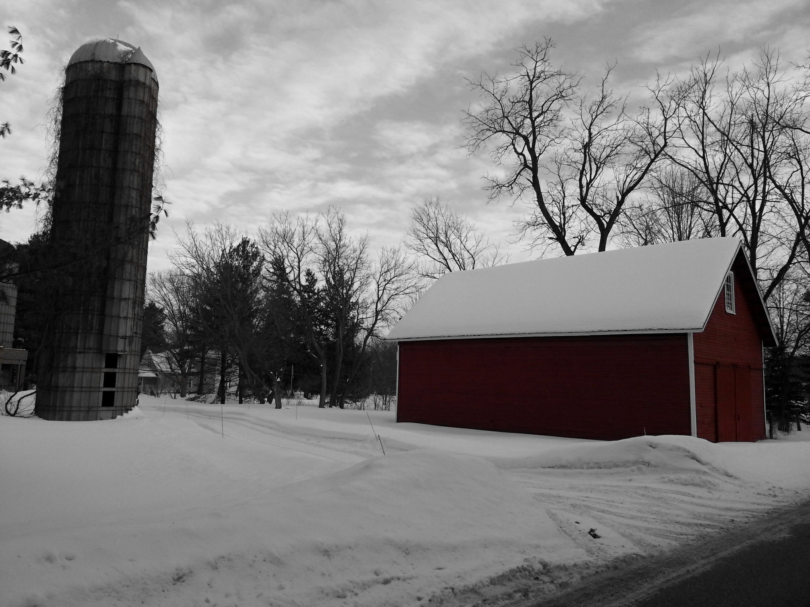 snow, winter, cold temperature, bare tree, building exterior, architecture, built structure, weather, season, tree, sky, house, covering, cloud - sky, field, landscape, white color, nature, residential structure, tranquility