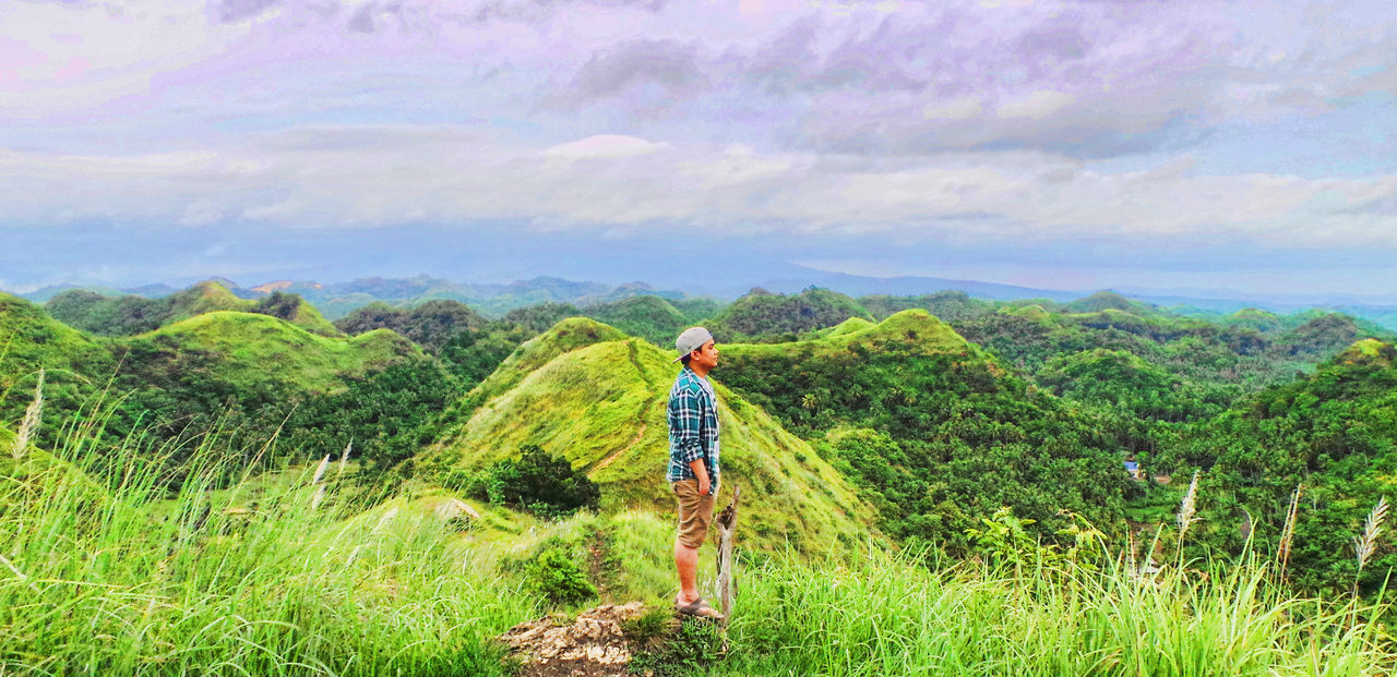 """Life isn't about finding yourself. Life is about creating yourself."" Beauty In Nature Check This Out EyeEm Eyeem Albay Eyeem Collection EyeEm Gallery Eyeem Market EyeEm Nature Collection EyeEm Nature Lover Eyeem Philippines Green Color Hill Top Landscape Mountain Nature One Person Outdoors People Real People Rear View Sky Sky And Clouds Standing"