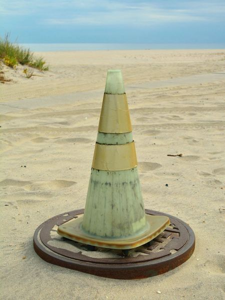 Random manhole and Road Cone At The Beach using Life 2 Filter