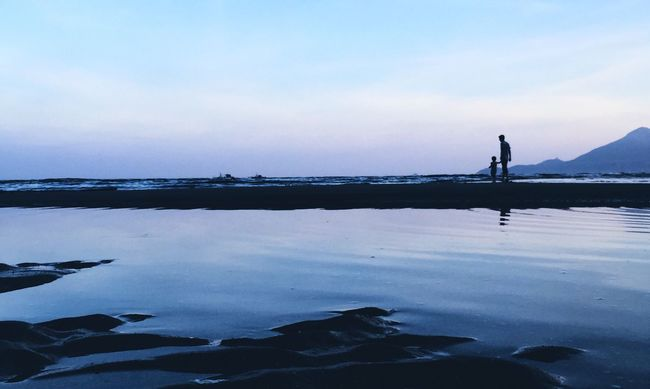 DONGSHAN ISLAND- 旅志 Water Reflection Sea Silhouette Beach Standing Tranquil Scene Sky Leisure Activity Scenics Men Nature Vacations Beauty In Nature Cloud - Sky Cloud Outdoors Calm Standing Water