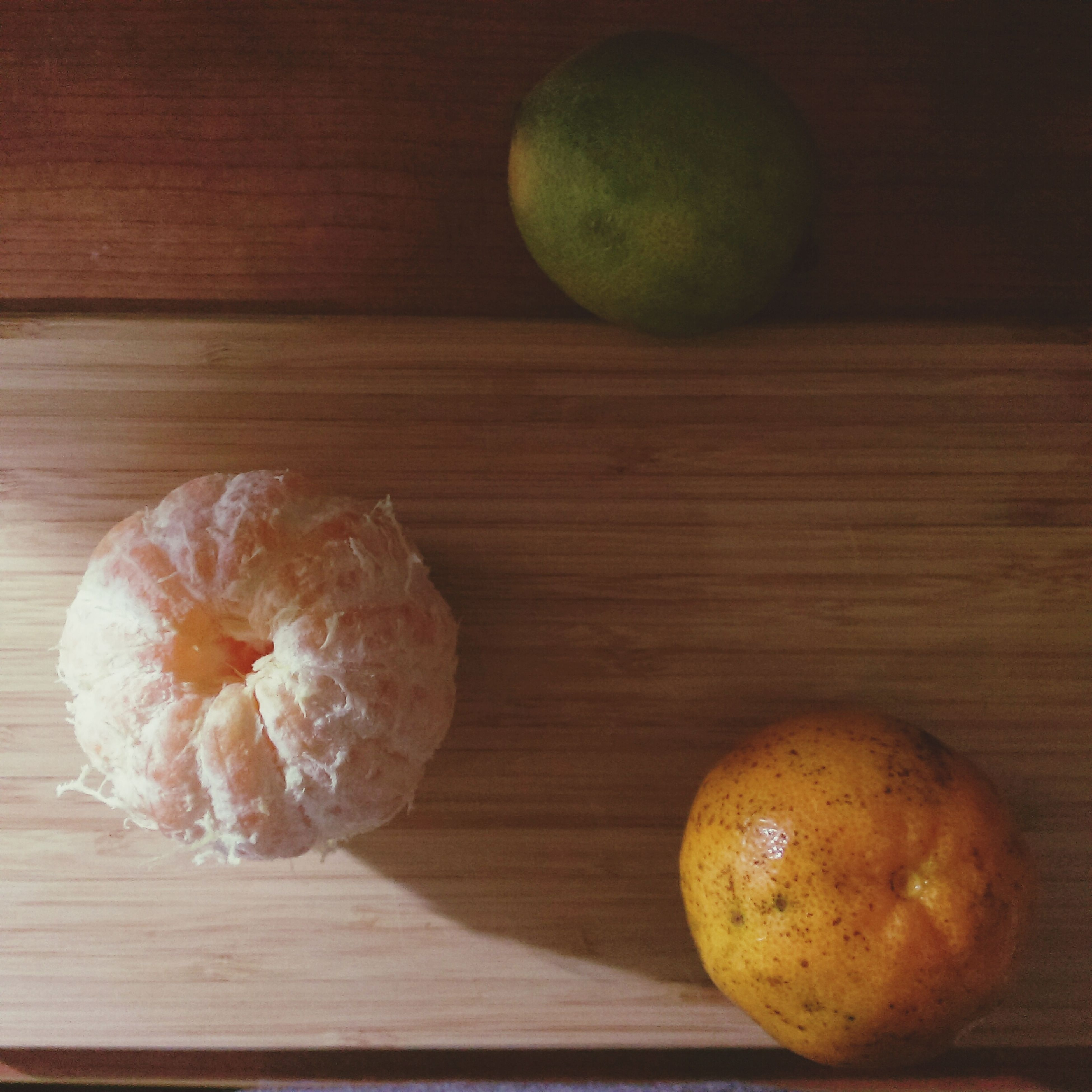 food and drink, indoors, food, table, freshness, still life, healthy eating, wood - material, fruit, wooden, close-up, high angle view, ready-to-eat, vegetable, no people, wood, directly above, slice, sweet food, bread