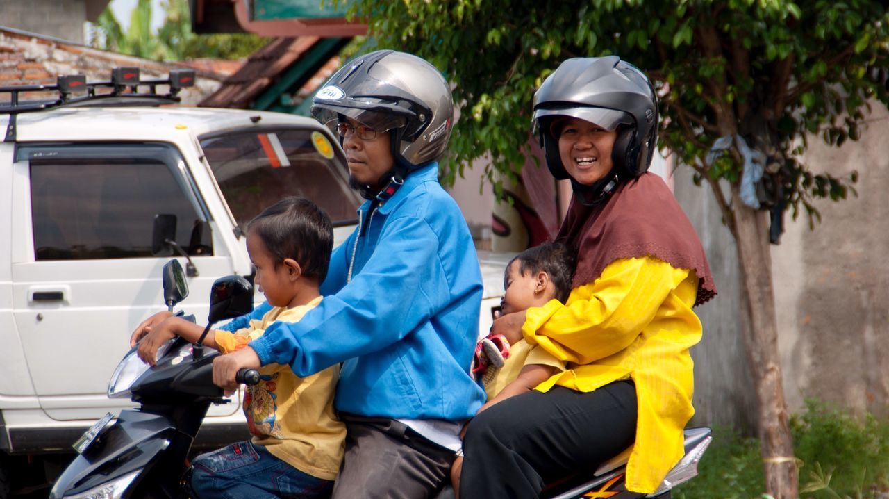 Four People On A Motorcycle Family Child Transportation Sports Helmet Happiness Outdoors Adult Togetherness People Helmet Headwear Day