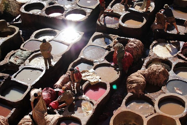 Ancient Workplace with Water Clay Colors and Hard Working people - they at Dyeing Sheep skin