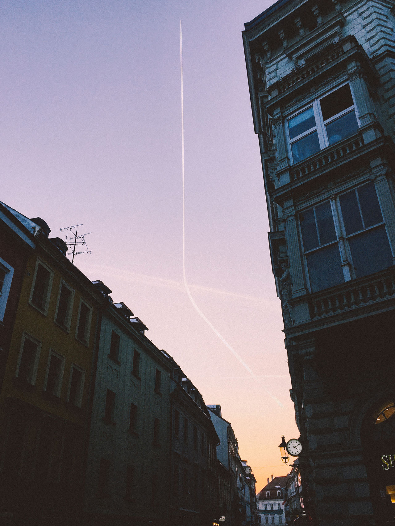 Adapted To The City Aeroplane Architecture Building Exterior Built Structure City Clock Curves Curves And Lines Day Escape Escape From Reality Evening Sky Flying Lines Low Angle View No People Outdoors Passing Time Sky Street Streetphotography Sunset Tranquility Transportation