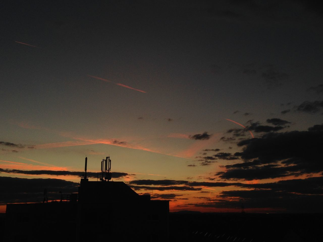 silhouette, sunset, sky, built structure, no people, vapor trail, architecture, outdoors, nature, contrail, airplane, day