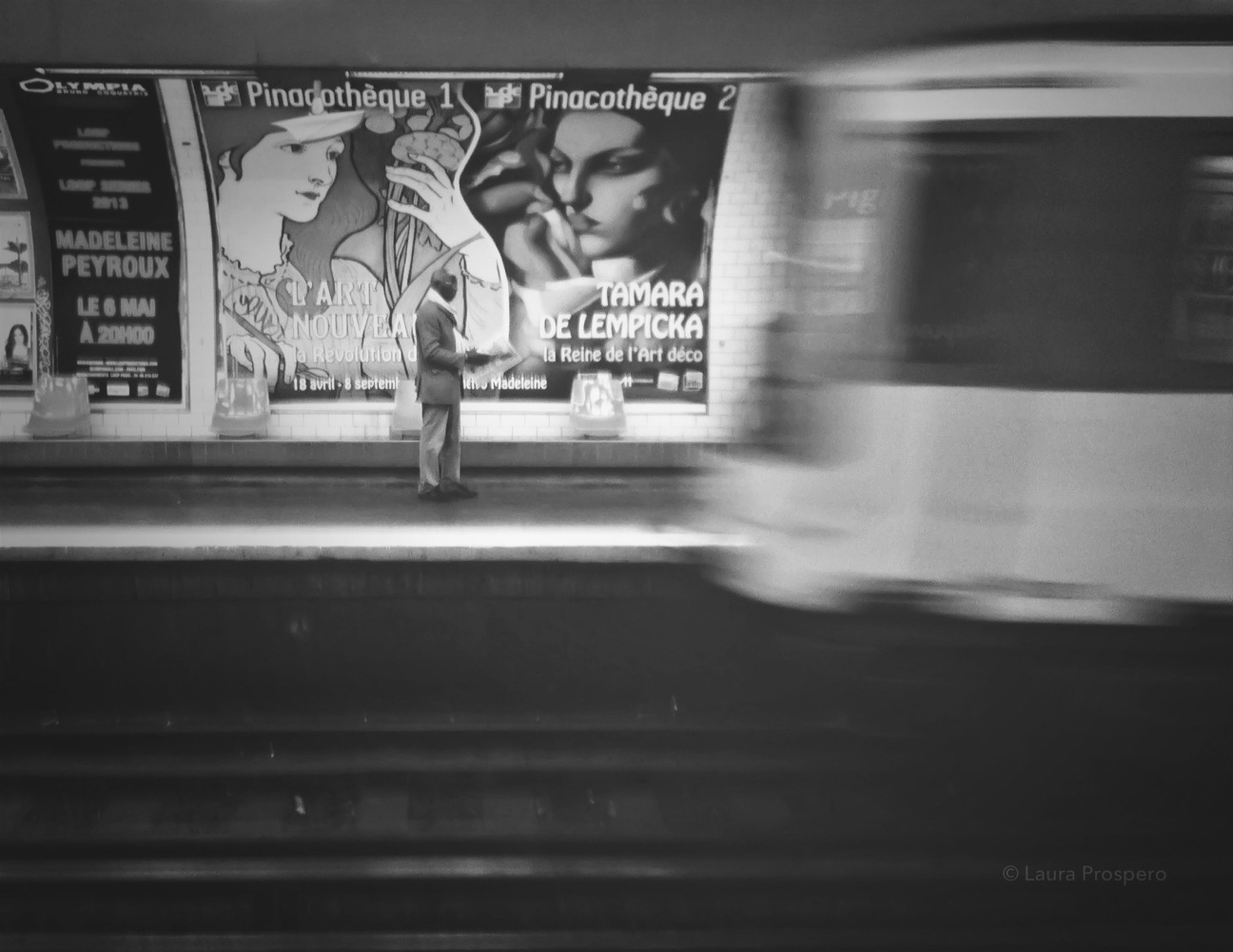 indoors, illuminated, architecture, built structure, tunnel, subway, transportation, railroad station, subway station, text, full length, blurred motion, men, graffiti, steps, wall - building feature, public transportation, ceiling