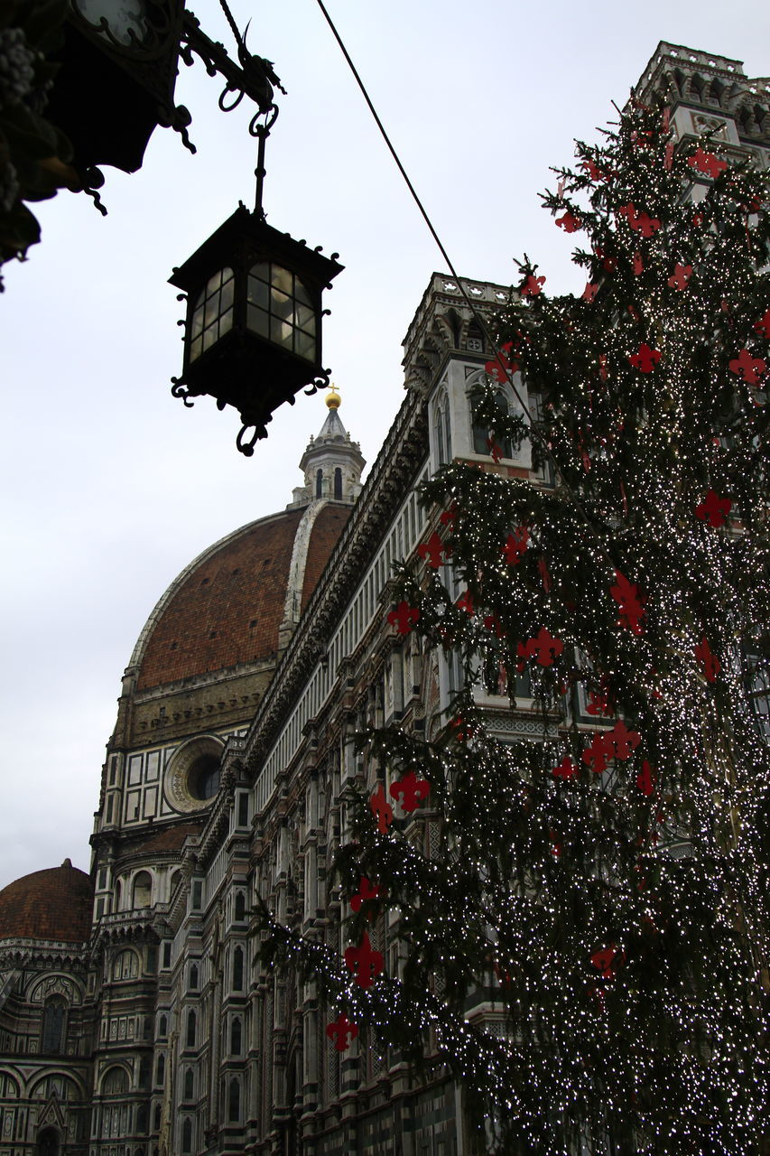 Low Angle View Of Christmas Tree Against Duomo Santa Maria Del Fiore