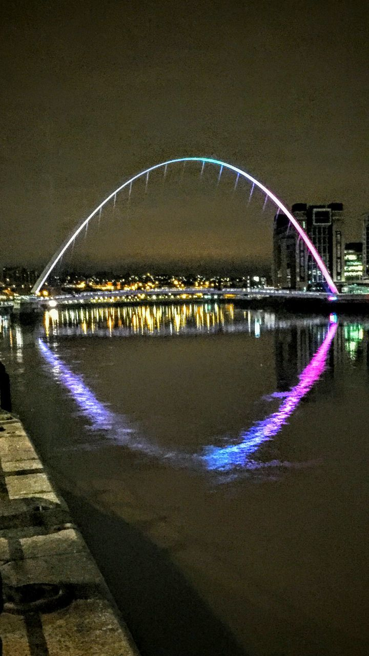 bridge - man made structure, connection, architecture, water, built structure, river, arch, reflection, no people, outdoors, illuminated, night, building exterior, sky