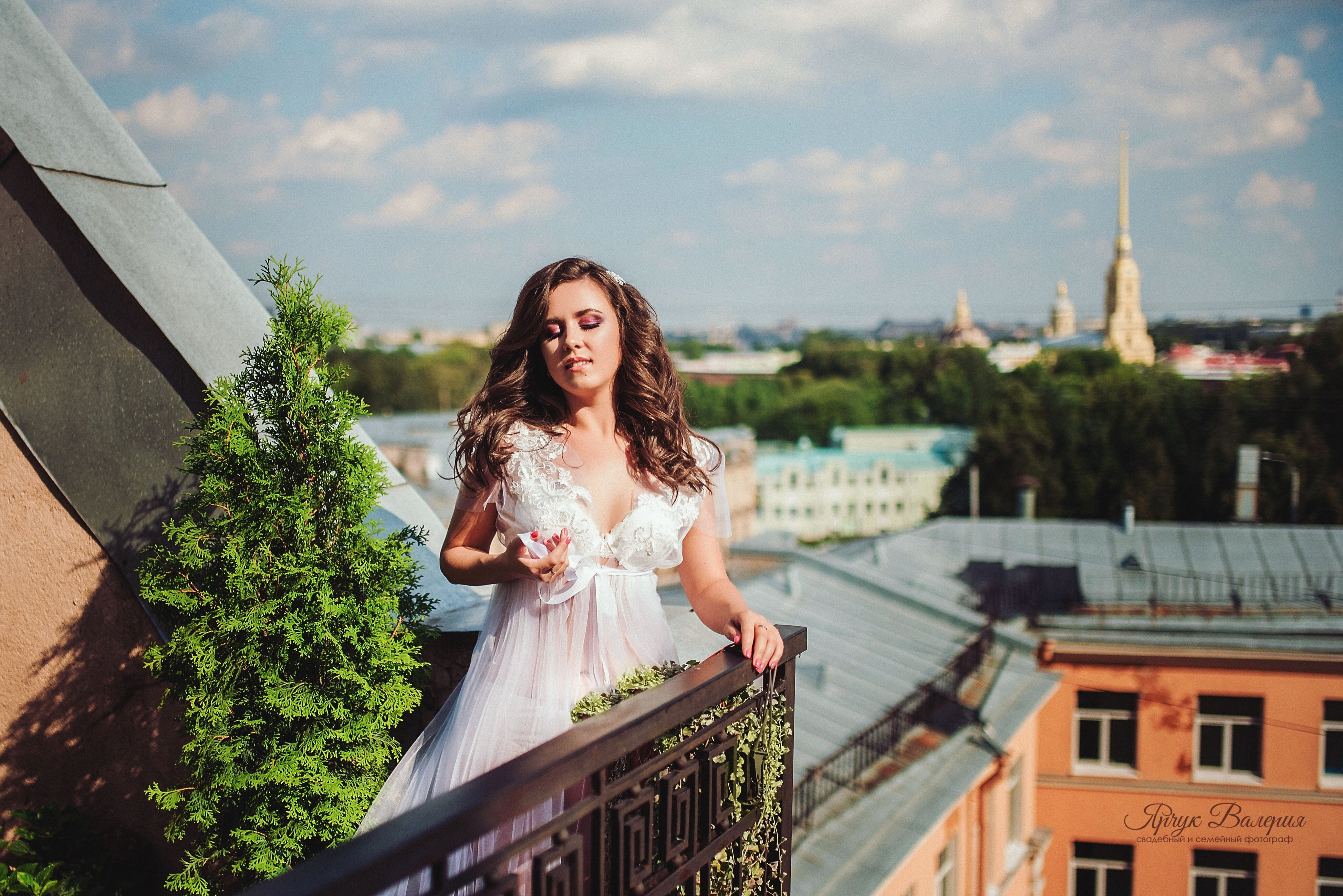 architecture, built structure, building exterior, sky, young women, young adult, tree, casual clothing, long hair, city, person, beauty, place of worship, city life, focus on foreground, day, outdoors, terrace, cloud - sky