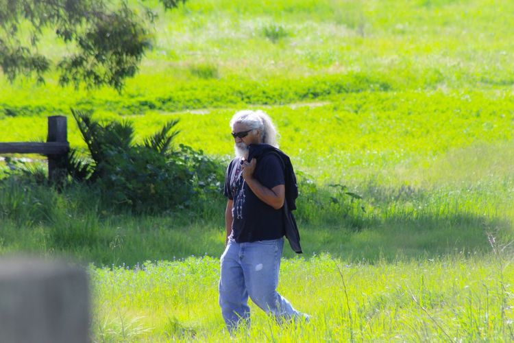 Peaceful Walk Lush Quiet Thinking Time Alone Mature Holding Jacket White Hair White Beard Relaxing Eyemphotography EyeEm Gallery Eyem Nature Lovers  Enjoying Life Grassy