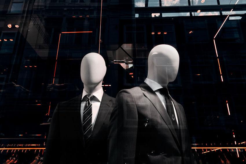 Dark Fashion Mannequin Suit Advertisement Highlights Hugo Boss Male Mannequin Retail  Shop Store Suit Window