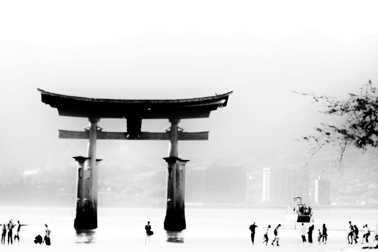 Torri Gate In Lake At Itsukushima Shrine