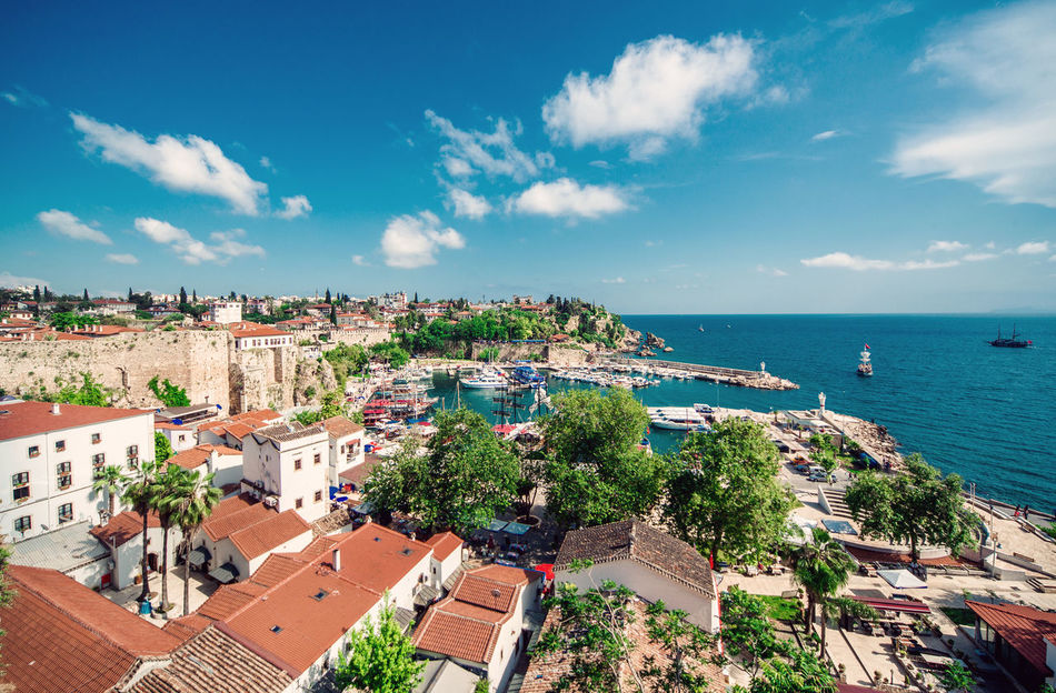Antalya cityscape. Turkish resort Antalya Turkey Architecture ASIA City Cityscape Harbor Horizon Over Water Houses Landscape Middle East Nature Outdoors Port Rooftops Scenery Seaport South Summer Tourism Town Travel Destinations Tropical Climate Turkey Turkish Riviera Urban Landscape
