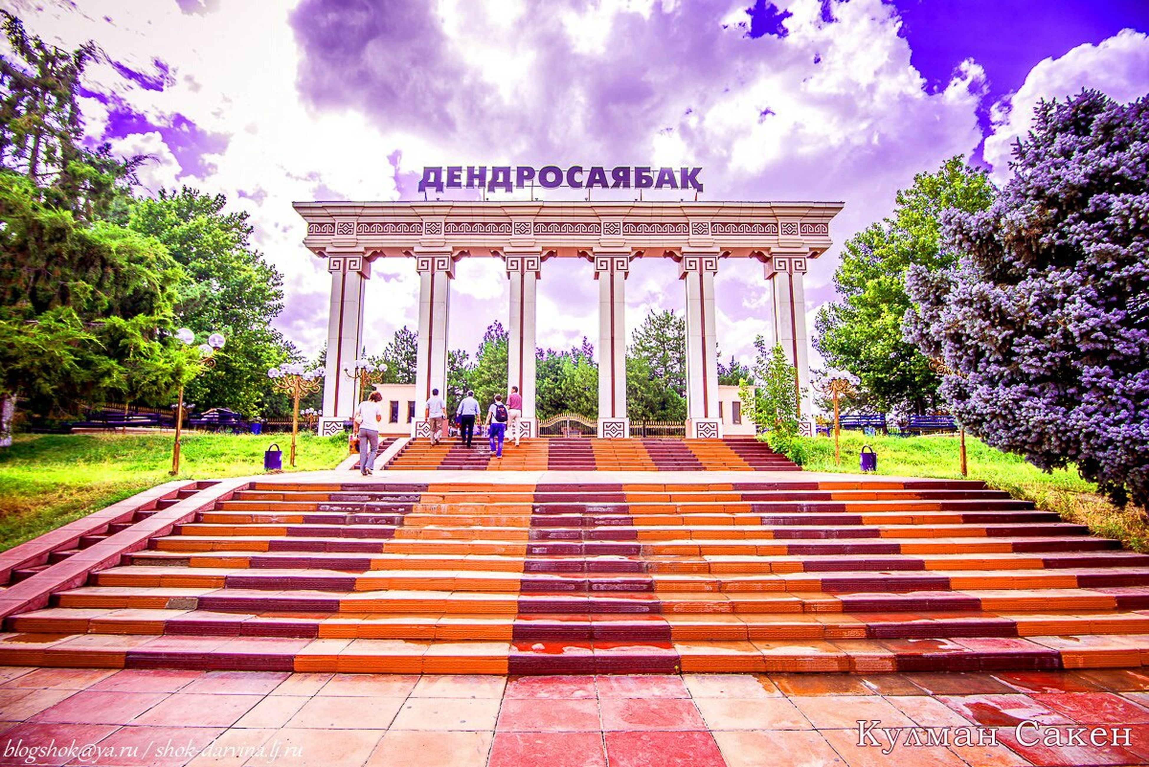 sky, built structure, tree, architecture, building exterior, cloud - sky, travel destinations, cloud, famous place, tourism, steps, outdoors, travel, park - man made space, architectural column, day, sunlight, incidental people, fountain, cloudy