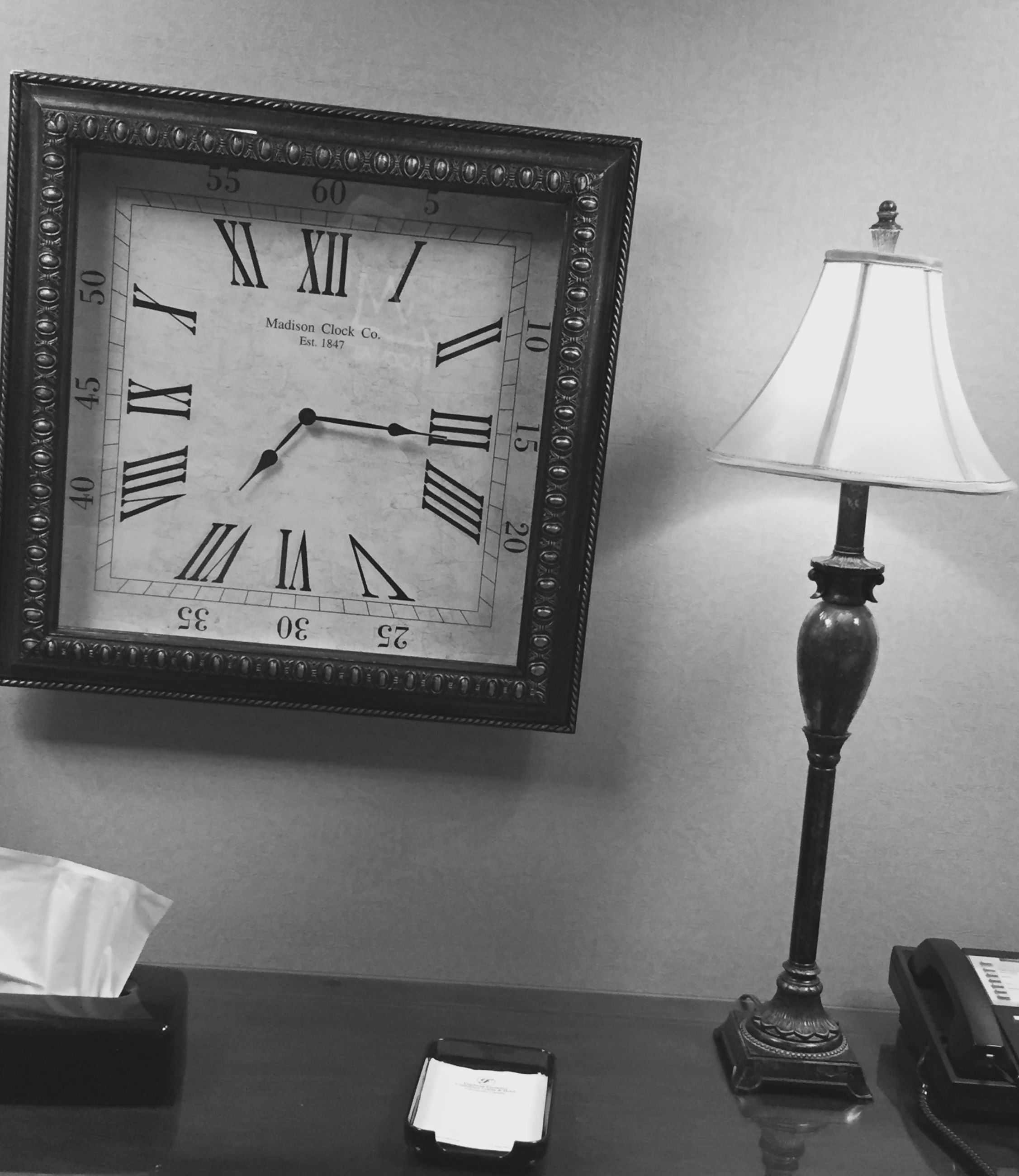 communication, text, indoors, western script, clock, table, time, close-up, lighting equipment, no people, accuracy, still life, guidance, number, wall - building feature, paper, information sign, sign, low angle view, non-western script