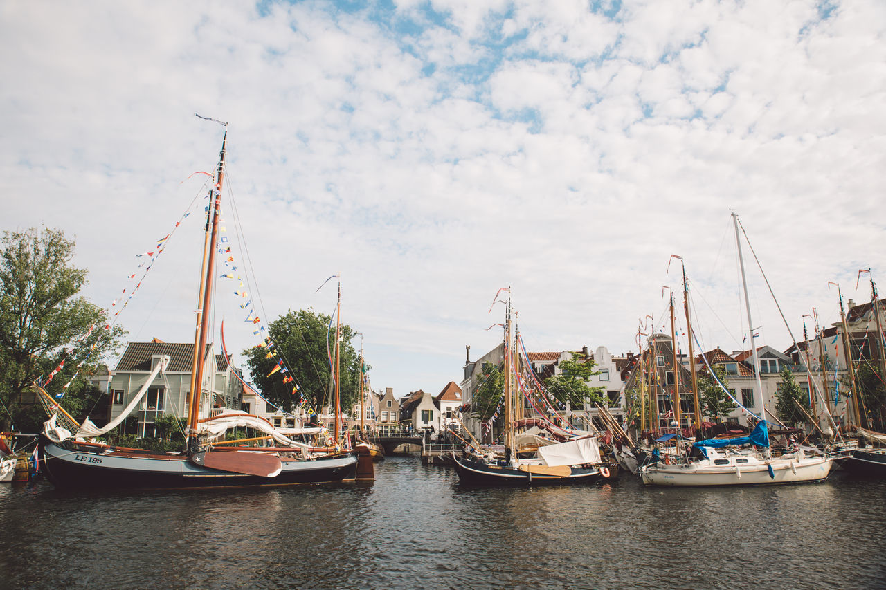 Architecture Haarlem Haarlemse Haarlemse Vaardagen 2017 Architecture Boats Building Exterior Built Structure Canal City Cloud - Sky Cruise Day Dutch Harbor Mast Mode Of Transport Moored Nature Nautical Vessel No People Outdoors River Ships Sky Spaarne Transportation Travel Destinations Tree Vaardagen Water Waterfront