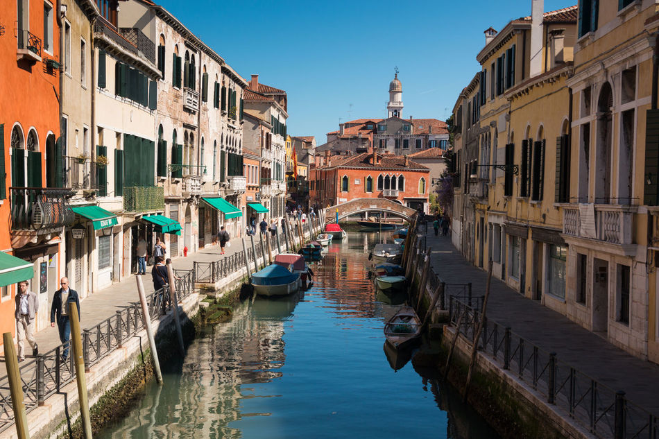 Architecture Building Exterior Built Structure Canal City Clear Sky Day Gondola - Traditional Boat Italy Mode Of Transport Moored Nautical Vessel Outdoors Real People Residential Building Sky Sunlight Transportation Venice, Italy Water Waterfront Wooden Post