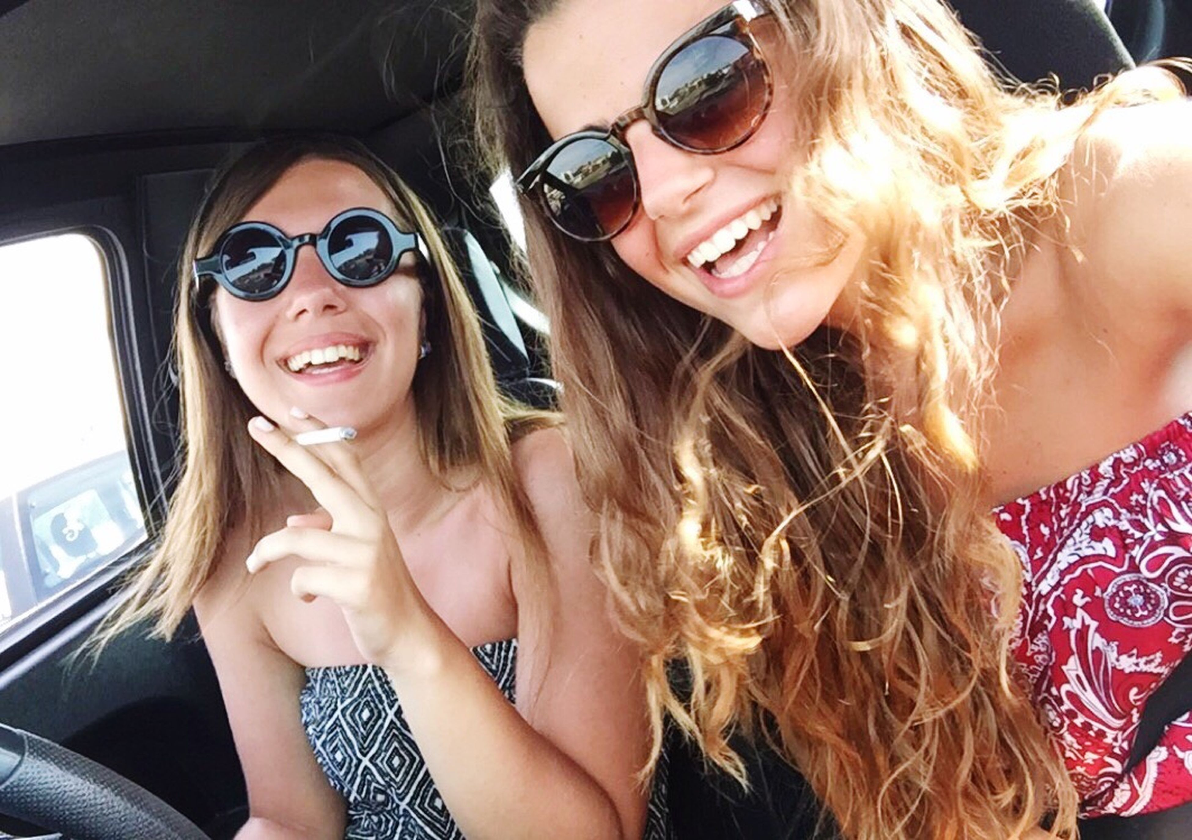 young adult, young women, person, portrait, looking at camera, lifestyles, leisure activity, smiling, front view, long hair, happiness, toothy smile, sunglasses, casual clothing, togetherness, bonding