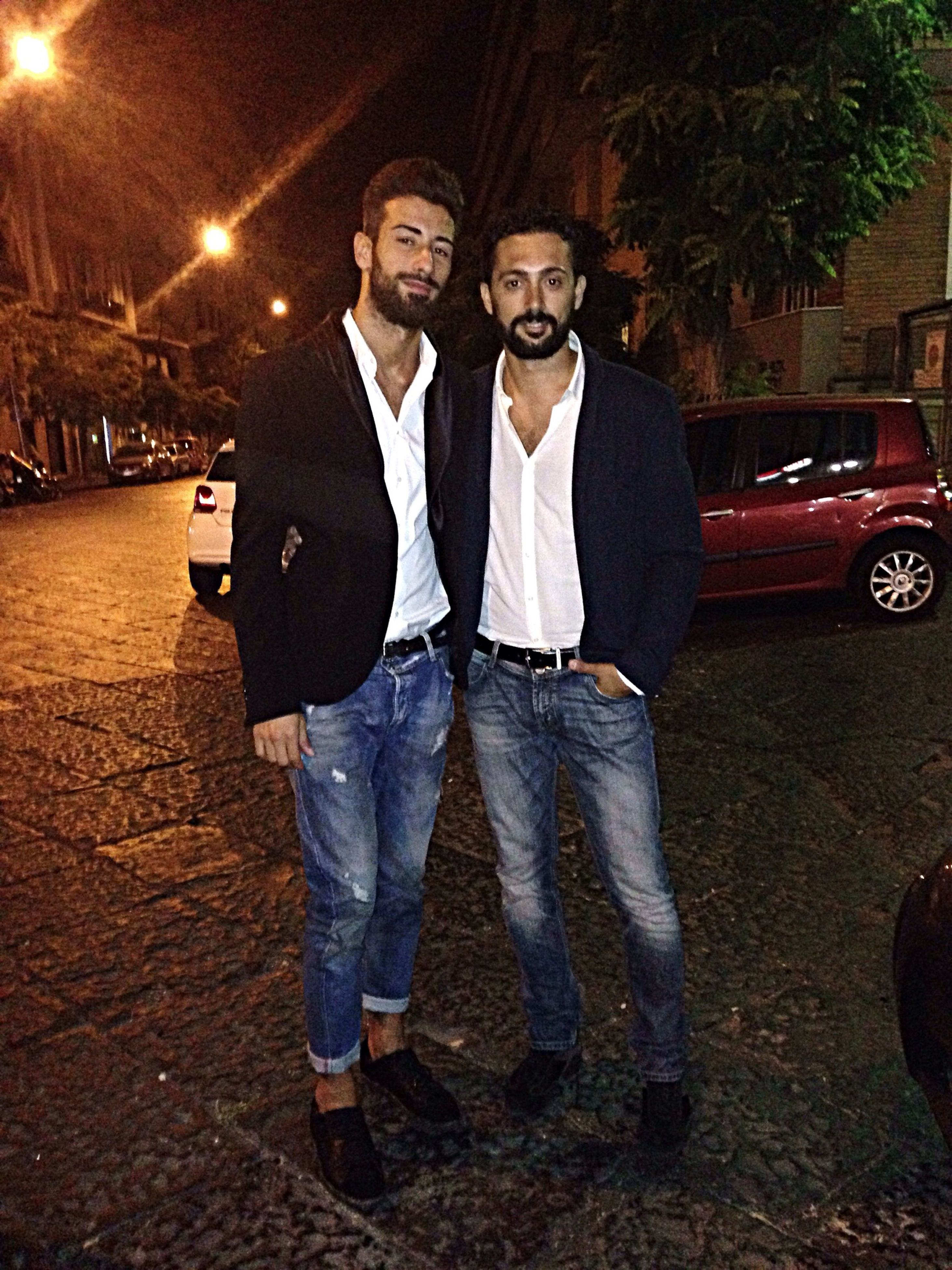 lifestyles, casual clothing, full length, leisure activity, front view, person, togetherness, standing, looking at camera, portrait, night, street, bonding, young men, car, transportation, young adult