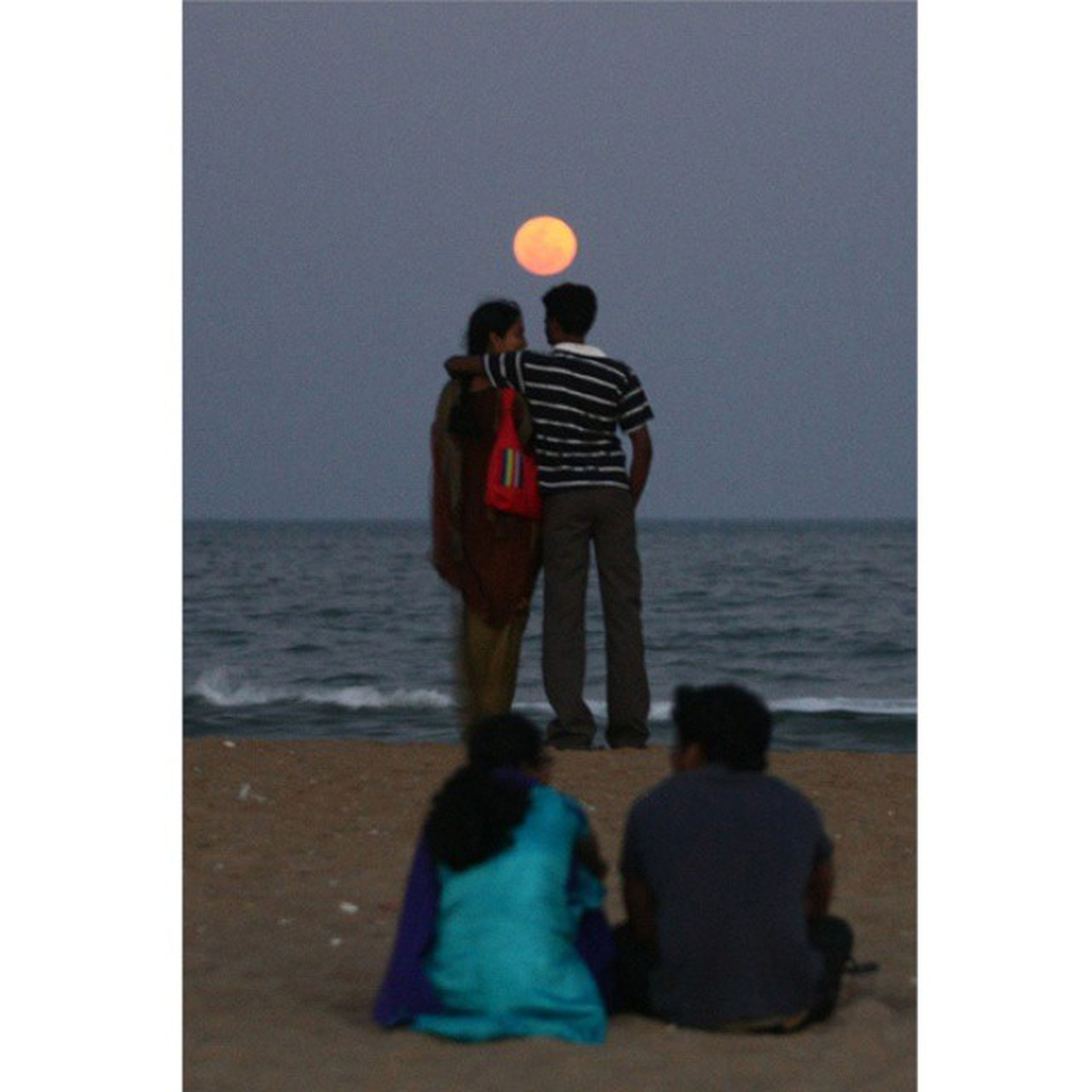 sea, rear view, lifestyles, horizon over water, leisure activity, water, full length, togetherness, transfer print, men, bonding, standing, love, person, auto post production filter, casual clothing, clear sky, beach