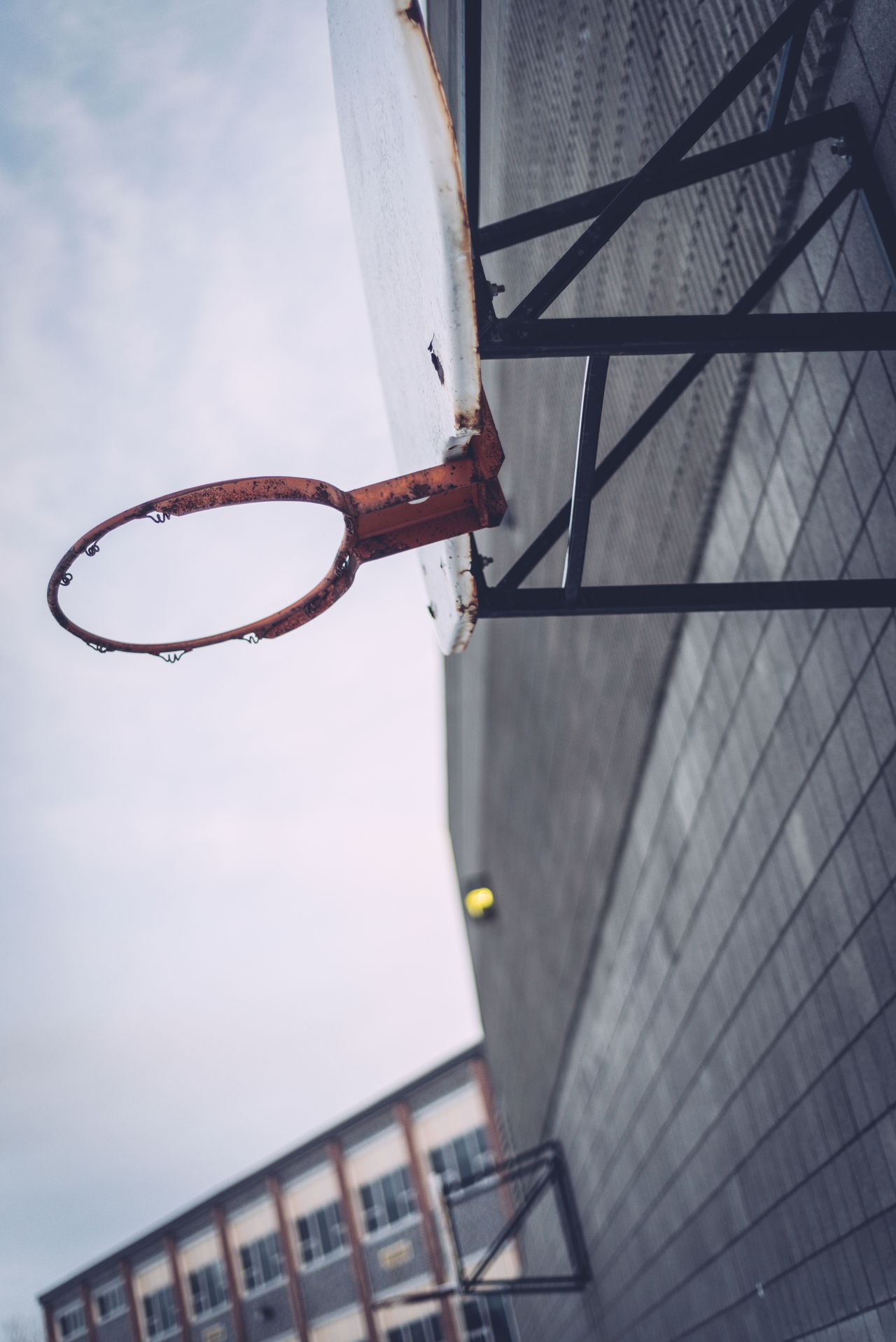 Angled Wall Basketball Net  Basketball Rim Close-up Cloud - Sky Day Low Angle View No People Outdoors School Schoolyard Sky
