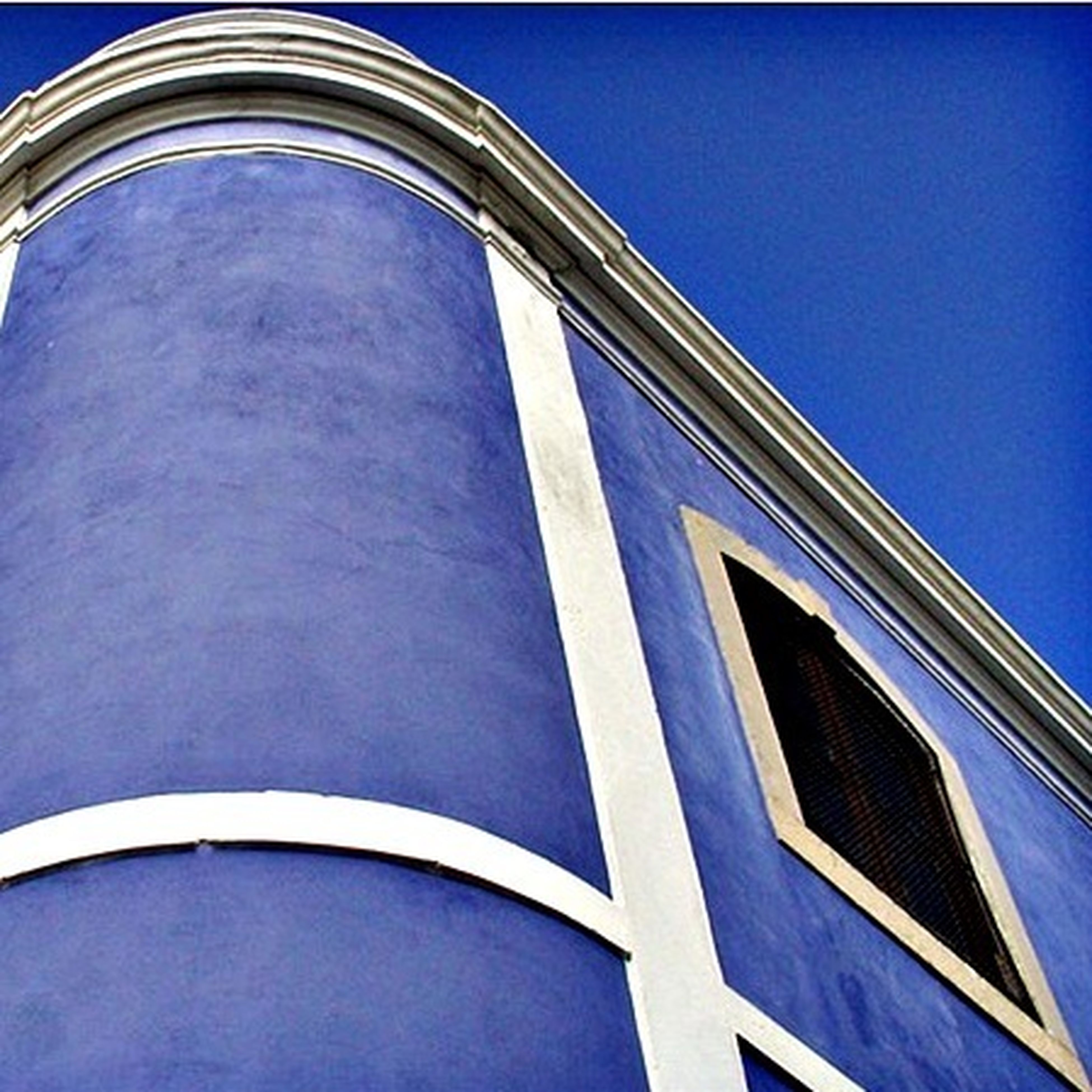 blue, low angle view, architecture, built structure, building exterior, clear sky, window, building, glass - material, reflection, modern, copy space, day, no people, outdoors, sunlight, sky, high section, pattern, part of