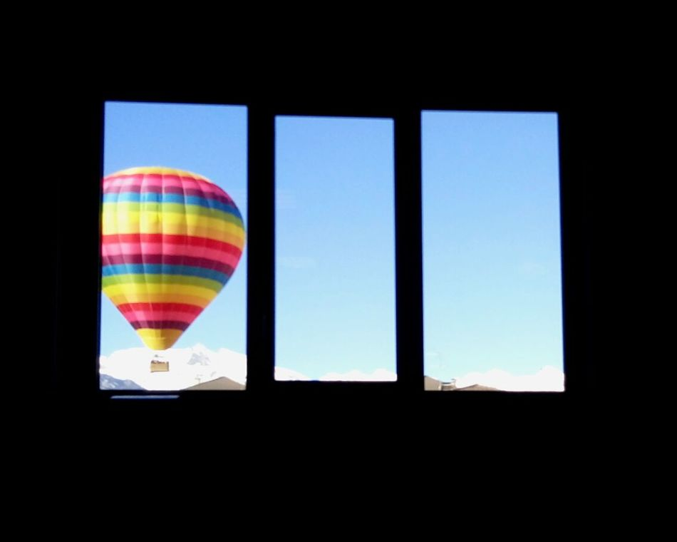 Ti coloro la giornata Multi Colored Window City Sky Day No People Outdoors Hot Air Balloon Rainbow Windows Colors Hope Dream Children Dreams Happiness Fly presso Aosta Aosta Valley Italy Italia EyeEmNewHere