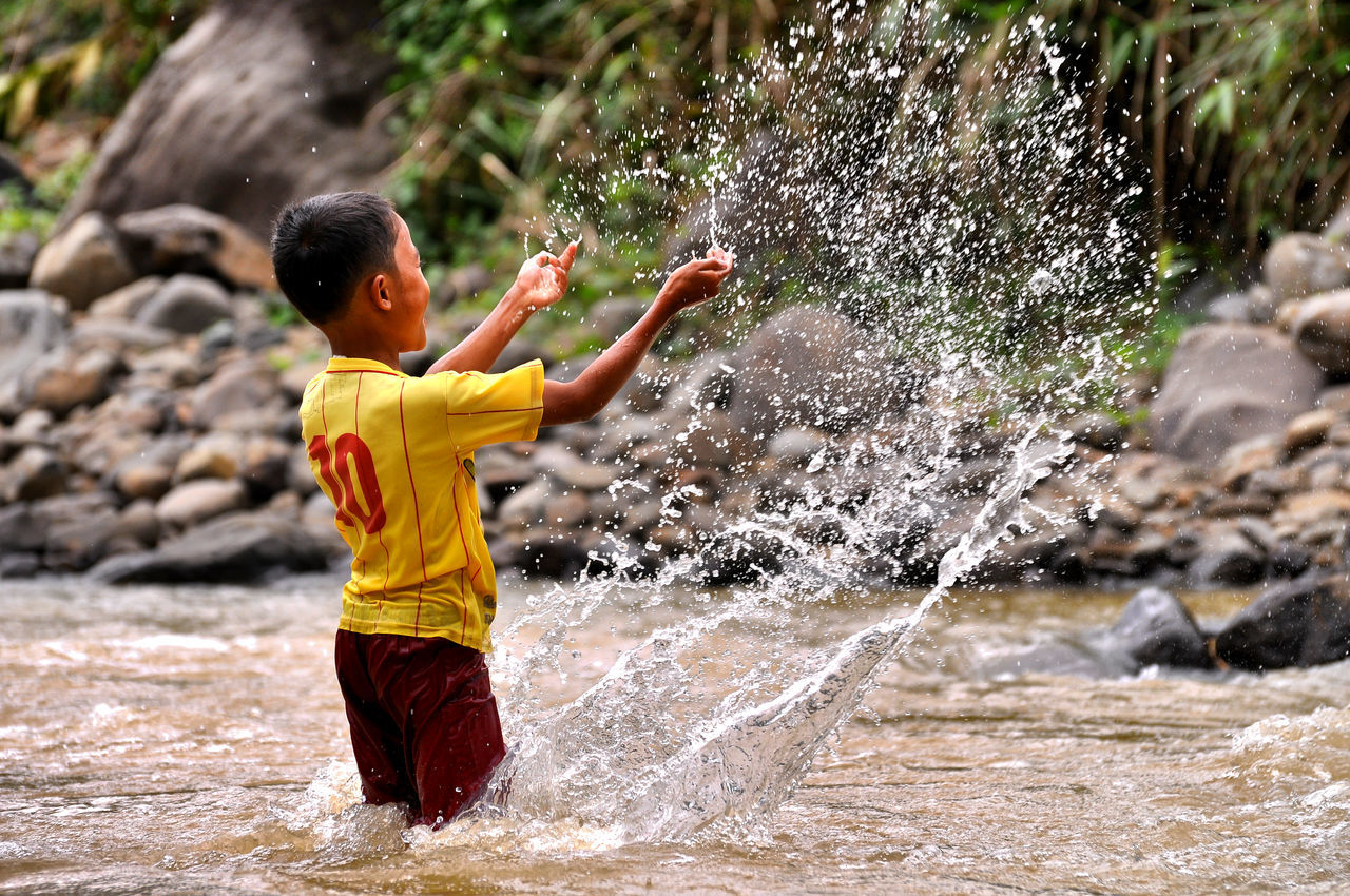frezze Bogor Boys BYOPaper! Childhood Day Elementary Age EyeEmNewHere FREZZING Lifestyles Motion Nature One Boy Only One Person Outdoors People Real People Rock - Object Shirtless The Great Outdoors - 2017 EyeEm Awards The Photojournalist - 2017 EyeEm Awards Water Waterfall