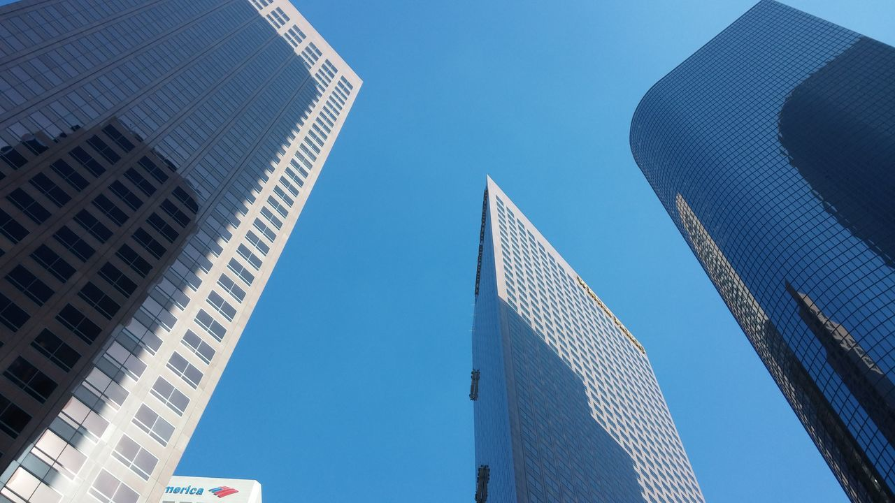 architecture, low angle view, building exterior, built structure, skyscraper, modern, clear sky, blue, city, day, outdoors, no people, sky, office park