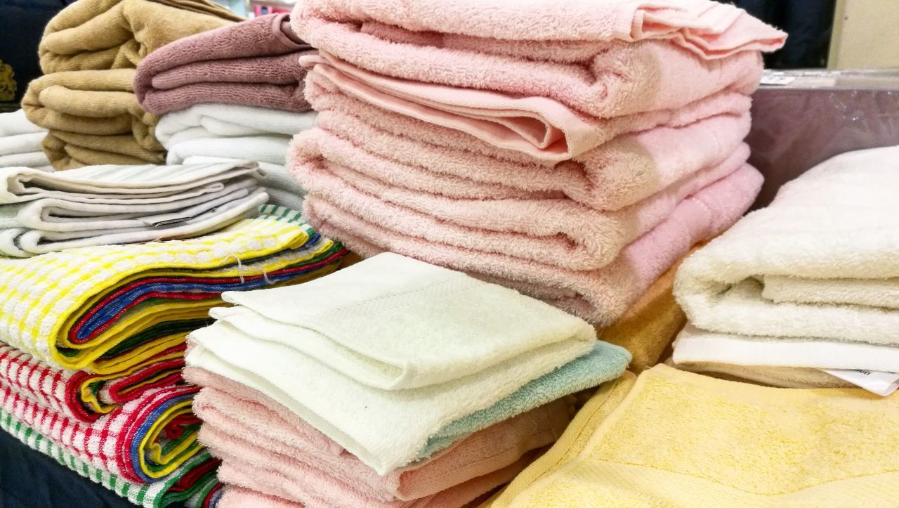 Towels Towel Art 😆 Towel Art Towelscupulture Towel Cover Stack Multi Colored Large Group Of Objects Retail  Close-up Outdoors No People Day