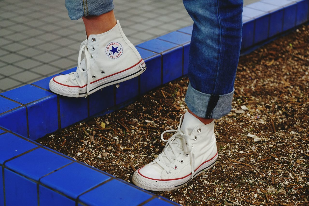 Low Section Shoe Blue Human Leg Standing Adults OnlyConverse Shoes Shoes Human Body Part One Person People Close-up One Woman Only Canvas Shoe Day Outdoors Adult Converse All Star Conver