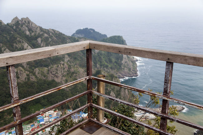 Ulleungdo is the most mysterious island. It is located at East Sea of South Korea. I have been there for 13 days for photo travel. Beauty In Nature Cliff Day Guard Rail Island Mountain Nature No People Non-urban Scene Observation Point Observatory Obsolete Outdoors Railing Scenics Sea Sky Tranquil Scene Tranquility Ulleungdo Water Waterfront