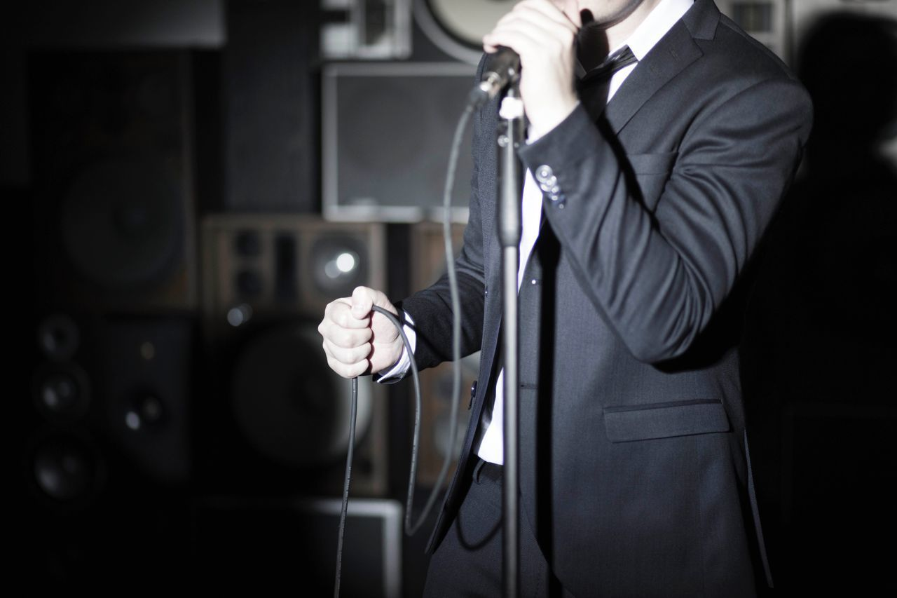 Midsection One Person Holding Men Well-dressed Suit Standing Uniform Indoors  Human Hand One Man Only Real People Night Technology Businessman Close-up Adult People Singer  Microphone Sound Speaker