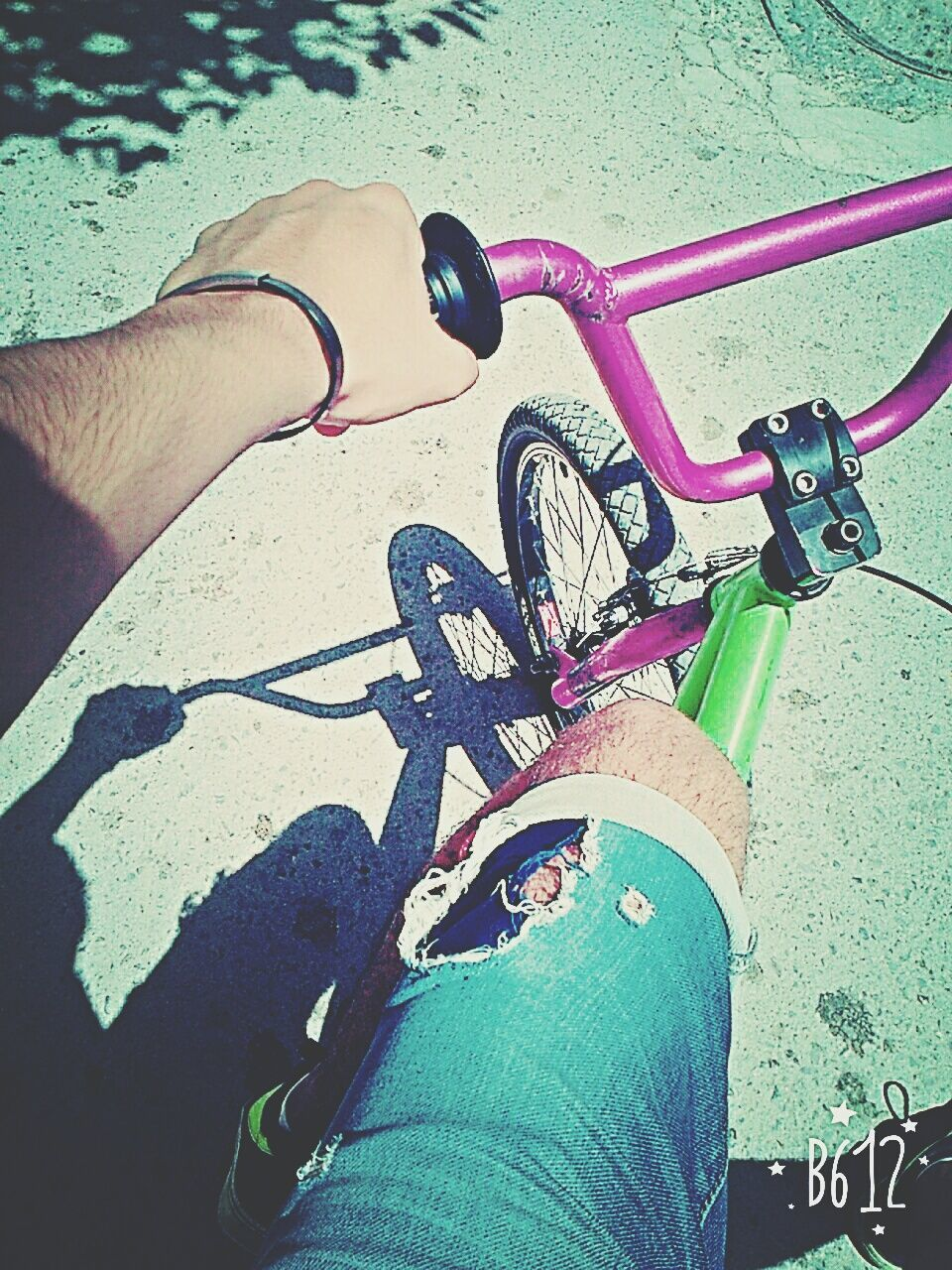 human leg, human body part, low section, personal perspective, one person, real people, bicycle, lifestyles, high angle view, human hand, outdoors, leisure activity, riding, sunlight, shadow, transportation, day, road, close-up, women, men, adult, people, adults only