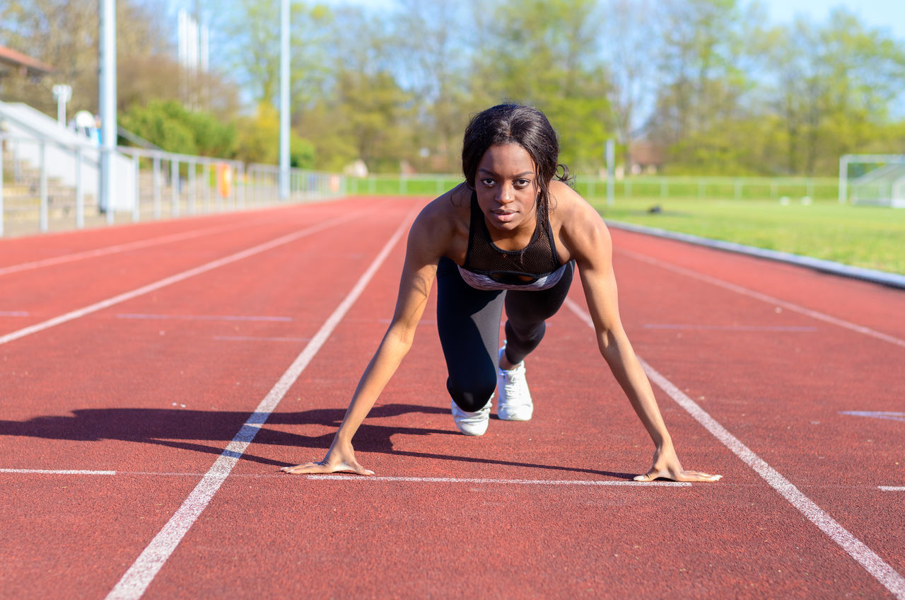 Athlete Challenge Competition Competitive Sport Day Determination Effort Exercising Full Length Healthy Lifestyle Lifestyles Only Women Outdoors Real People Running Running Track Sport Sports Clothing Sports Race Sports Track Starting Line Track And Field Track And Field Athlete Track Starting Block Vitality