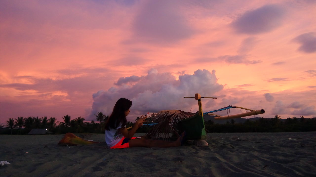sky, sunset, cloud - sky, outdoors, nature, beach, sand, scenics, men, beauty in nature, sea, one person, day, people