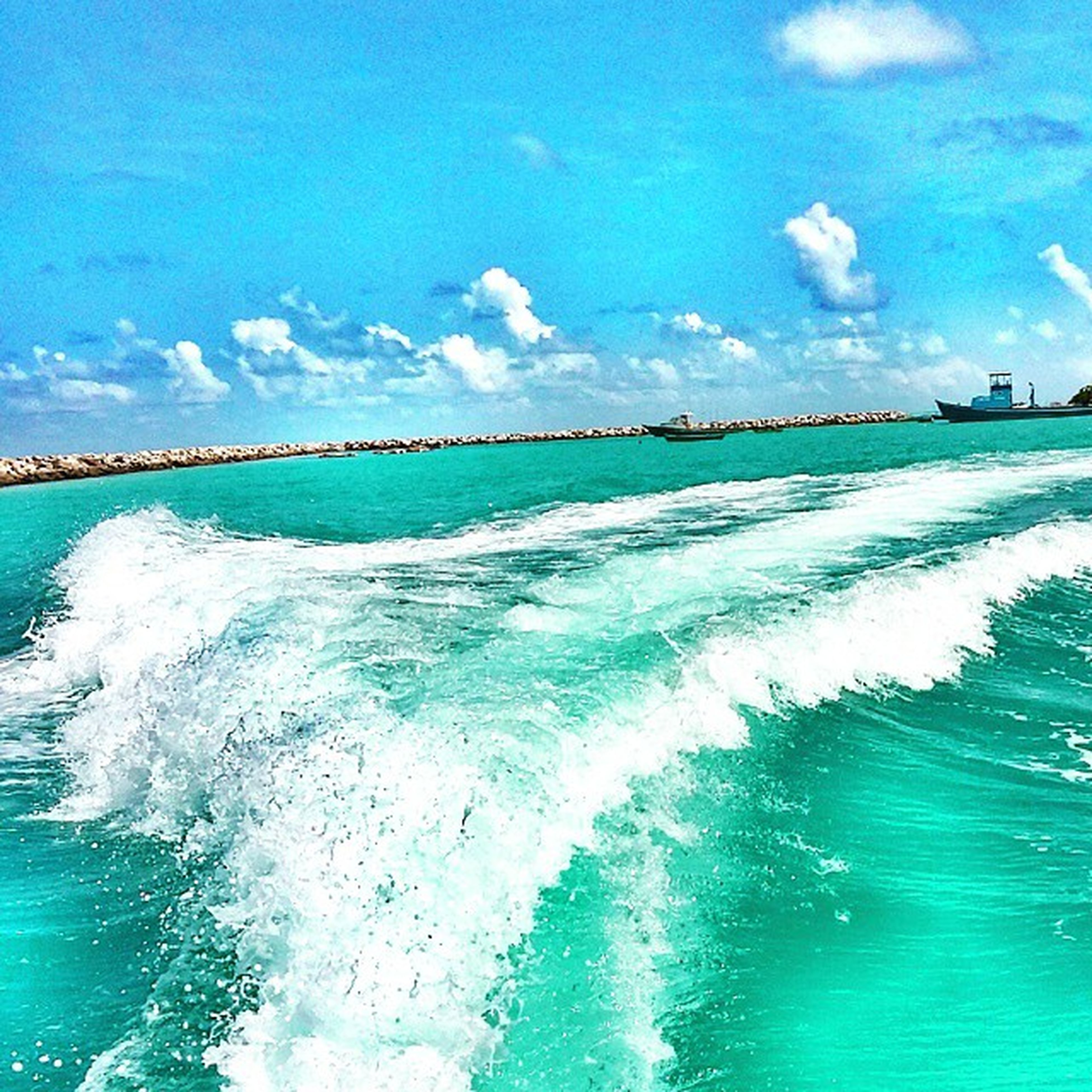 sea, water, blue, horizon over water, sky, wave, scenics, beauty in nature, beach, surf, tranquil scene, nature, tranquility, turquoise colored, motion, waterfront, idyllic, cloud - sky, shore, seascape