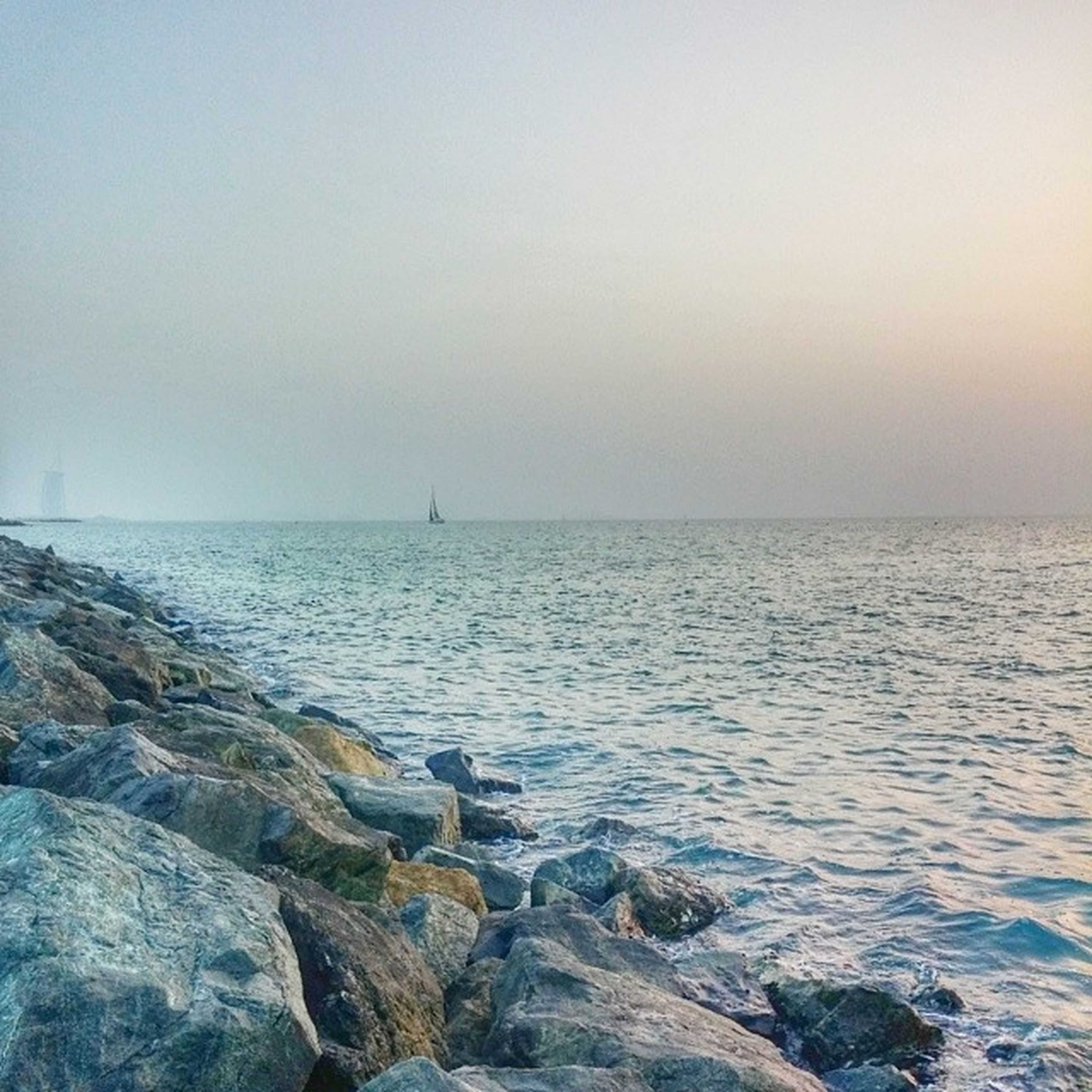 sea, water, horizon over water, scenics, tranquil scene, tranquility, beauty in nature, copy space, clear sky, rock - object, nature, idyllic, seascape, shore, sky, remote, beach, sunset, calm, rippled