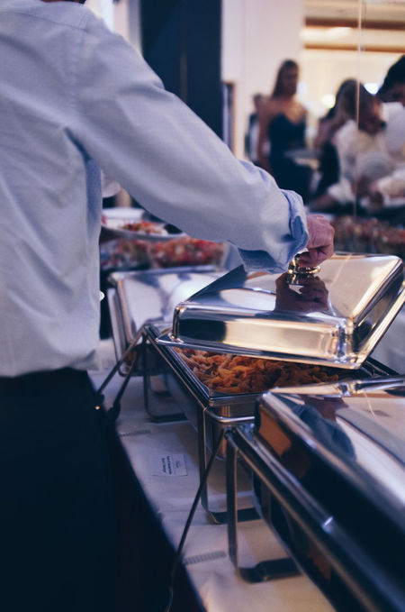 Warm food at Event Buffet Buffet Time Catering Catering Service Eat Eating Event Event Photographer EventPhotography Events Food Food And Drink Food And Drink Food Tray Help Yourself Human Hand Indoors  One Person Opening Pasta People Eating People Getting Food Real People Warm Food
