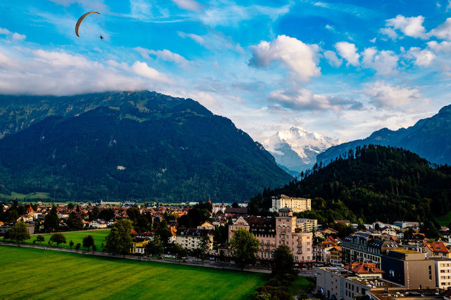 Aerial View Beauty In Nature Blue Cloud - Sky Cloudy Day Flying Green Color Interlaken Jungfrau Jungfrau - Top Of Europe Majestic Mountain Mountain Range Nature No People Non-urban Scene Outdoors Scenics Sky Switzerland Town Tranquil Scene Tranquility