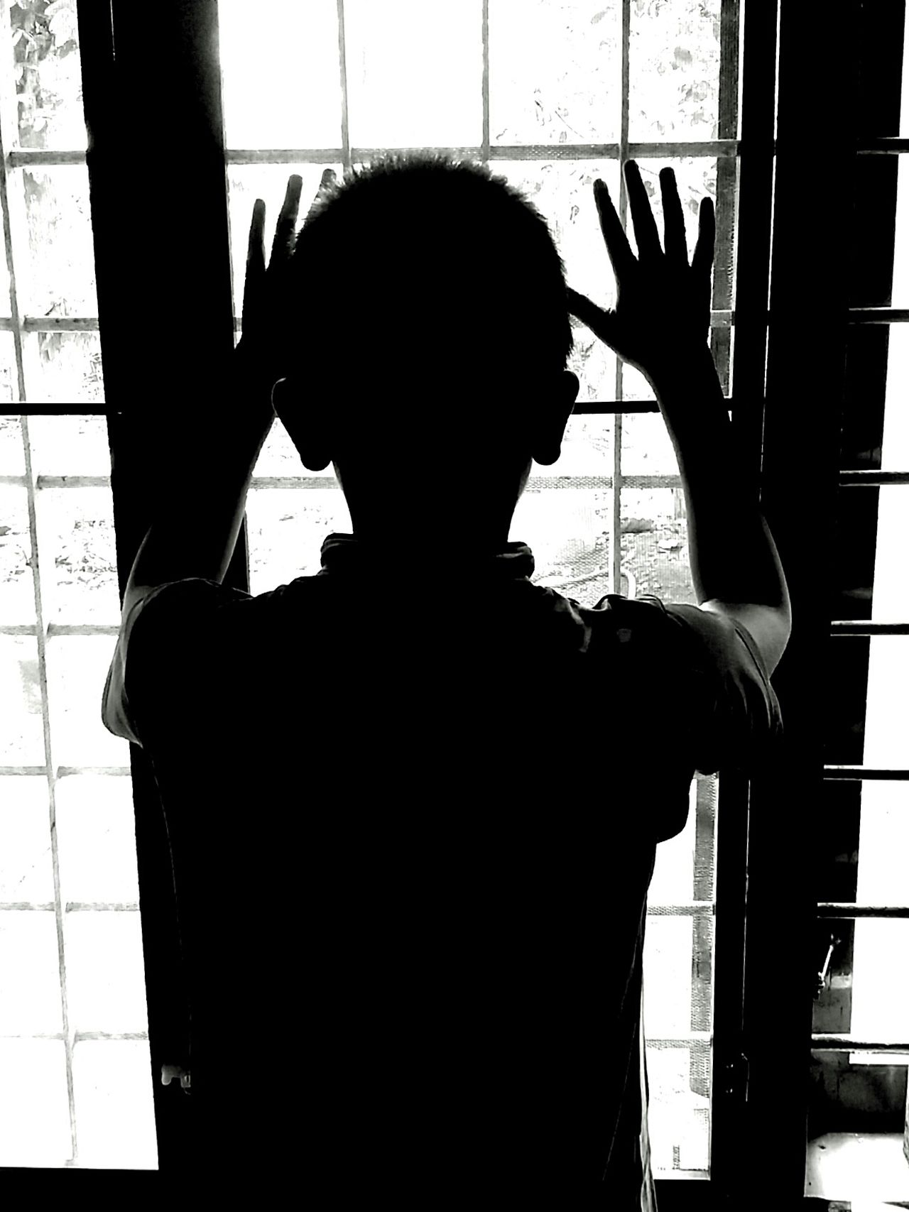 To Escape... Silhouette Indoors  Window One Person Day People Childhood Children Only Child Blackandwhite Escape Shadow Portraits Shadows & Lights Lights Shadow And Light Shadow Photography Silhouette The Portraitist - 2017 EyeEm Awards Real People Indoors  About A Boy One Boy Black And White One Boy Alone