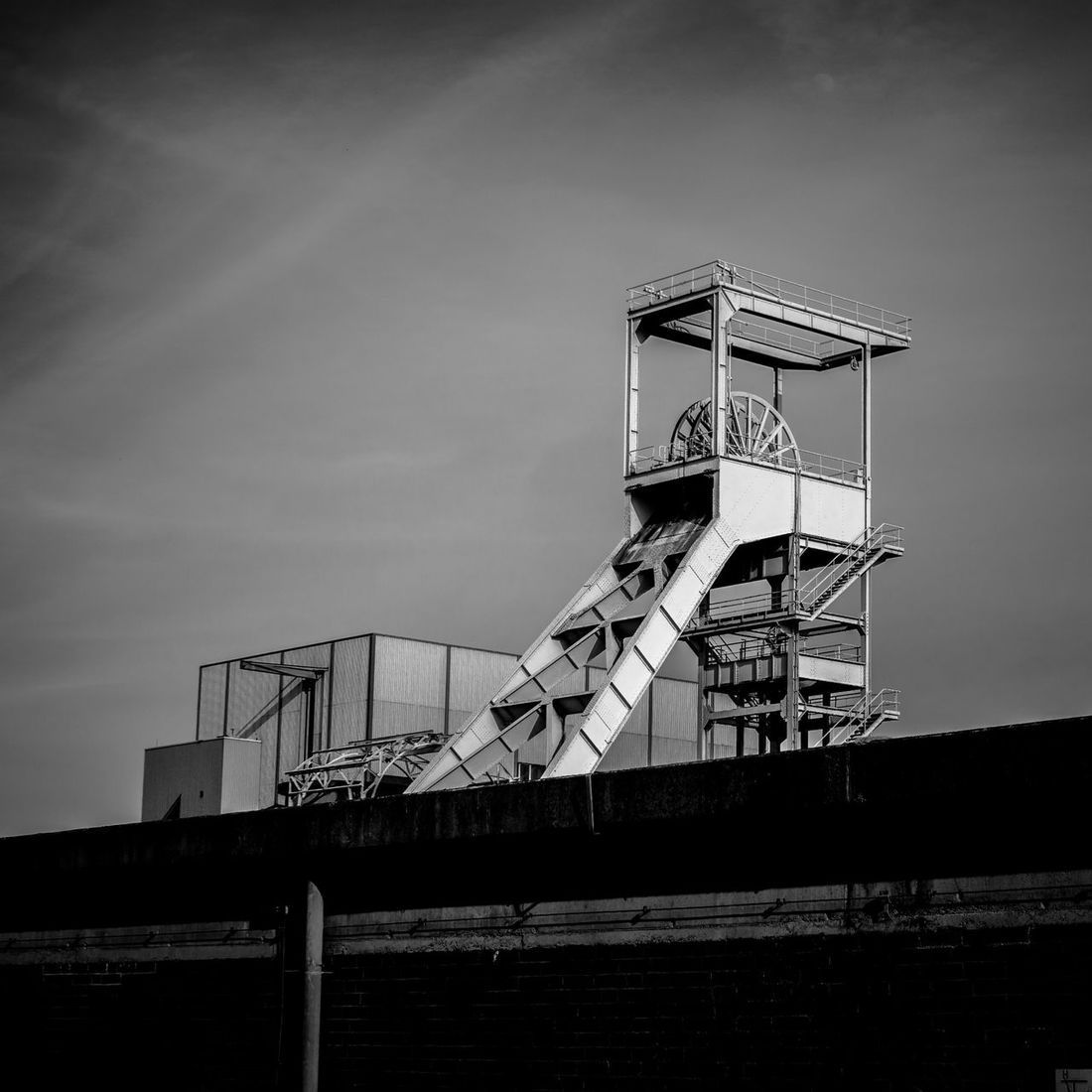 Winding Tower Headgear Architecture Built Structure Coal Mine Coal Mining Day Industrial Low Angle View No People Outdoors Shaft Tower Sky