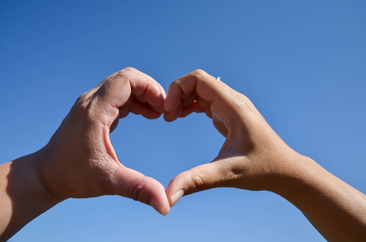 Blue Human Hand Love Human Body Part Heart Shape Clear Sky Two People Close-up Togetherness Sky Forming Day Outdoors People Adults Only Adult Vacations Valentine's Day