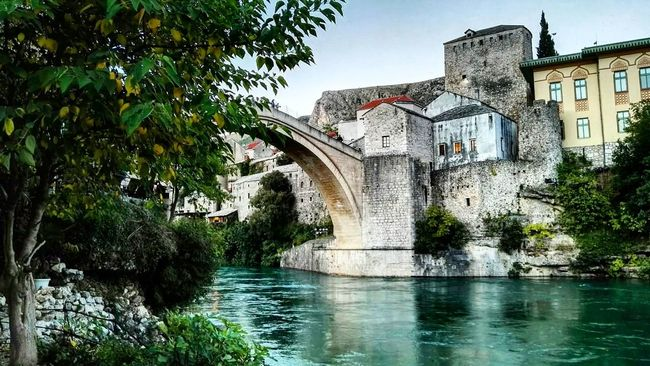 Building Exterior Architecture Built Structure Outdoors Nature No People Sky Day Tree Water Mostar Bosnia Mostar ♥ Beautiful Sky Nature_collection Beauty In Nature Bosnia And Herzegovina Nature Travel Photography Beautifulday Naturephotography Architecture Travel Tree Trees Bridge - Man Made Structure