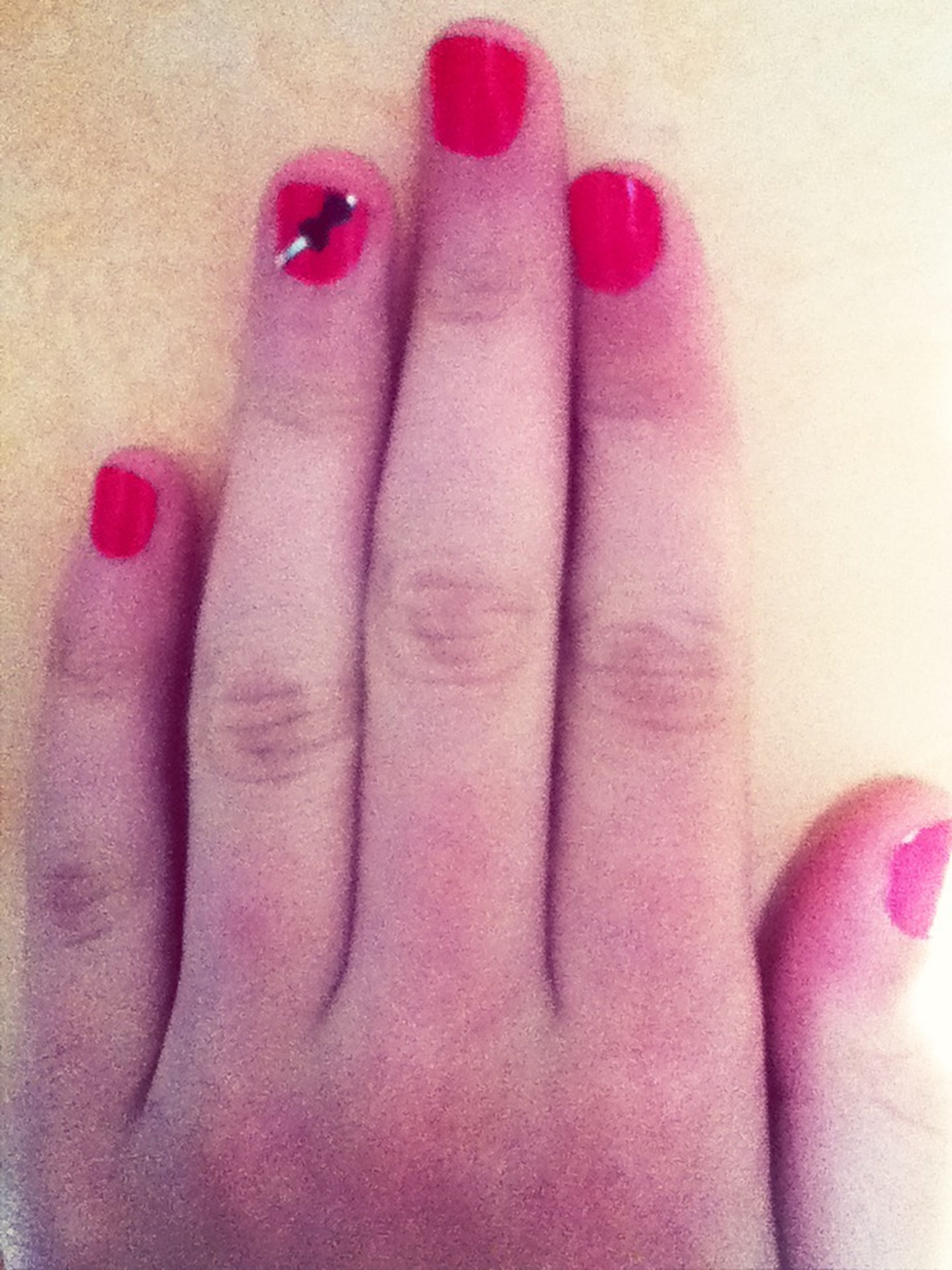 person, indoors, part of, lifestyles, femininity, human finger, close-up, nail polish, pink color, human skin, sensuality, cropped, red, leisure activity, fashion