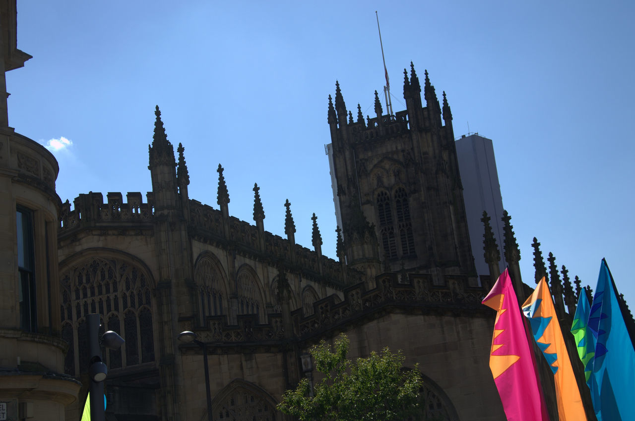 Abracadabra ABRACADABRA! Architecture Building Exterior Built Structure Clear Sky Day Flag Low Angle View Manchester Arena Bombing Manchestercathedral Manchesterday Multi Colored No People Outdoors Patriotism Sky
