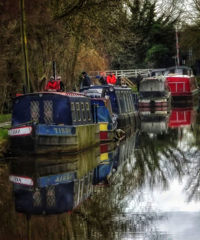 Canal boats along the Leeds Liverpool canal Ormskirk Water Reflection Waterfront Canal Outdoors Canals And Waterways UK Canals Canal Walks Leeds Liverpool Canal Canals Of England History Architecture EyeEm Masterclass Creative Light And Shadow Fujifilm Malephotographerofthemonth Creative Light And Shadow Color Photography Boats In A Line Boat Life