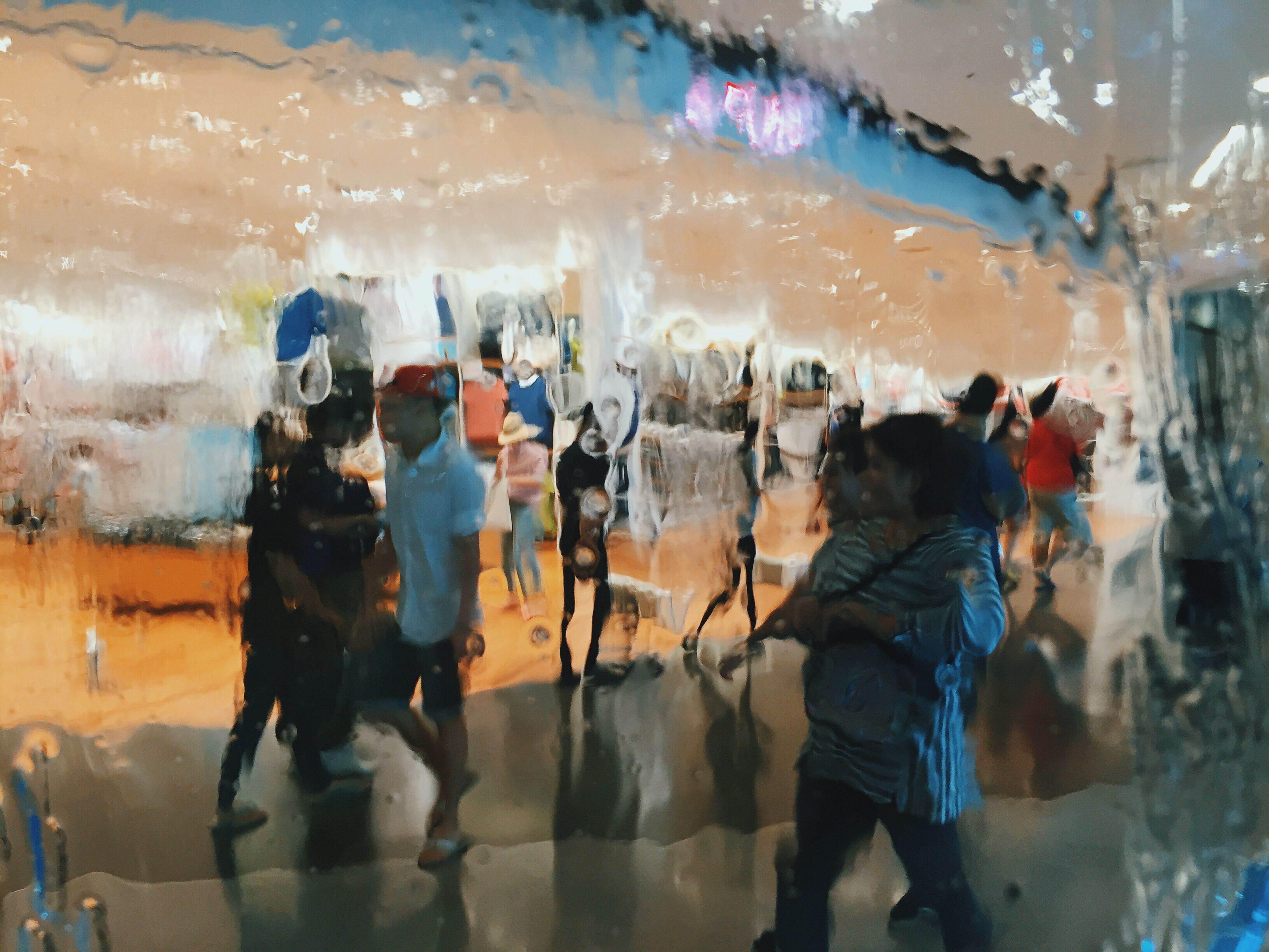 indoors, men, lifestyles, leisure activity, person, standing, glass - material, large group of people, rear view, transparent, water, casual clothing, togetherness, walking, wet, medium group of people, motion
